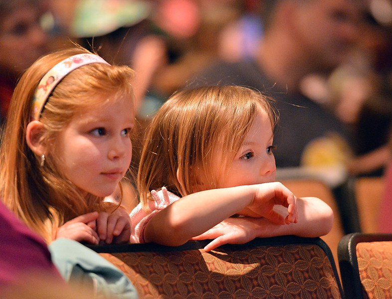 Siena Kidd, 5, left, and Clare Martin, 4, watch Peter Davison's performance during the Happy Noon Year celebration at the Audi on Monday.<br /> December 31, 2012<br /> staff photo/ David R. Jennings