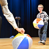 Jack Cohen , 8, helps performer Peter Davison juggle beach balls during the Happy Noon Year celebration at the Audi on Monday.<br /> December 31, 2012<br /> staff photo/ David R. Jennings