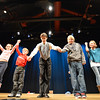 Peter Davison, center, takes a bow with children who assisted him during Davison's perfomance at the Happy Noon Year celebration at the Audi on Monday.<br /> December 31, 2012<br /> staff photo/ David R. Jennings