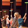 Ana Smith, 11, right, turns while holding spinning plastic plates with fellow children from the audience during Peter Davison's performance for the Happy Noon Year celebration at the Audi on Monday.<br /> December 31, 2012<br /> staff photo/ David R. Jennings