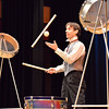 Peter Davison juggles a ball and drum sticks while playing the drums and reciting poetry during his performance at the Happy Noon Year celebration at the Audi on Monday.<br /> December 31, 2012<br /> staff photo/ David R. Jennings