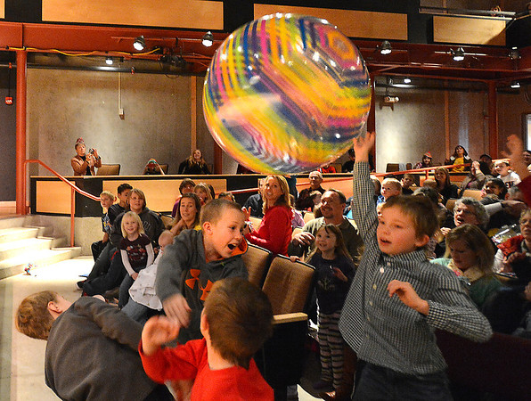 Boys hit a giant beach ball tossed to the  audience by performer Peter Davison during the Happy Noon Year celebration at the Audi on Monday.<br /> December 31, 2012<br /> staff photo/ David R. Jennings