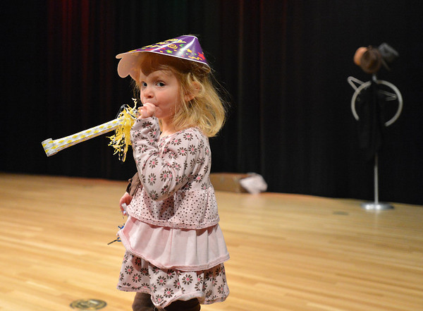 Mia Kidd, 3, blows her noise maker on stage after the count down to noon for  the Happy Noon Year celebration at the Audi on Monday.<br /> December 31, 2012<br /> staff photo/ David R. Jennings