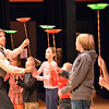 Peter Davison, left, keeps plastic plates spinning held by children form the audience during his performance at the Happy Noon Year celebration at the Audi on Monday.<br /> December 31, 2012<br /> staff photo/ David R. Jennings