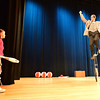 Jasmyn Liberatore, 6, left, waits to toss a juggling club to performer Peter Davison balanced on a unicycle  during the Happy Noon Year celebration  at the Audi on Monday.<br /> December 31, 2012<br /> staff photo/ David R. Jennings