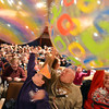 Jacob Barry, 8, left, and his grandfather Dan Sewald move giant beach balls around the audience at the Audi during the Happy Noon Year celebration on Monday.<br /> December 31, 2012<br /> staff photo/ David R. Jennings