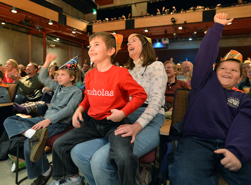 Nancy Kaastner, center, with her sons Michael Lee, 8, left, and Nicholas, 6, laugh with Jacob Barry, 8, at the performance of Peter Davison during the Happy Noon Year celebration at the Audi on Monday.<br /> December 31, 2012<br /> staff photo/ David R. Jennings