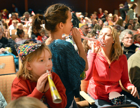 Hannah Christianson, 5, left, blows noise makers with her cousin Ana Smith, 11, and Hannah's mother Jennifer Christianson after the count down to noon during the Happy Noon Year celebration at the Audi on Monday.<br /> December 31, 2012<br /> staff photo/ David R. Jennings