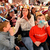 Nancy Kastner, center, blows her noise maker  with her sons MIchael Lee, 8, left, and Nicholas, 6, after the count down to noon during the Happy Noon Year celebration at the Audi on Monday.<br /> December 31, 2012<br /> staff photo/ David R. Jennings