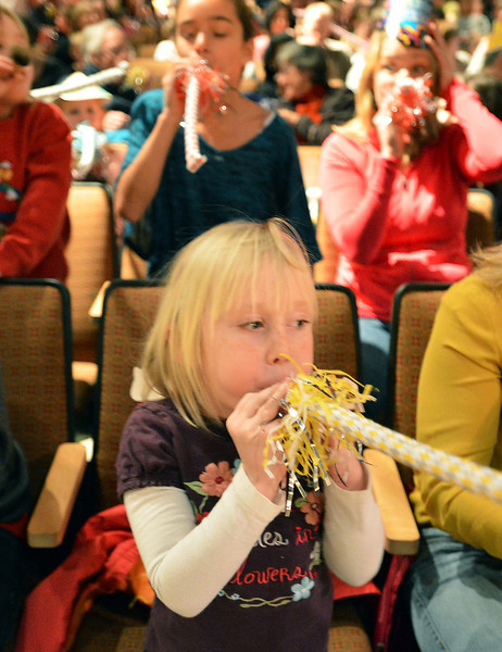 Greer Jorgensen,5, blows her noise maker after the count down to noon during the Happy Noon Year celebration at the Audi on Monday.<br /> December 31, 2012<br /> staff photo/ David R. Jennings