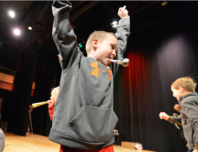 Weston Jorgensen, 9, cheers on stage while blowing a noise maker during the Happy Noon Year celebration with a sold out crowd at the Audi on Monday.<br /> December 31, 2012<br /> staff photo/ David R. Jennings