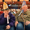 Jacob Barry, 8, left, blows noisemakers with his grandfather Dan Sewald after the count down to noon during the Happy Noon Year celebration at the Audi on Monday.<br /> December 31, 2012<br /> staff photo/ David R. Jennings