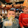 Michael Lee Kastner, 8, center, blows his noise maker with his brother Nicholas, 6, right, after the count down to noon during the Happy Noon Year celebration with a sold out crowd at the Audi on Monday.<br /> December 31, 2012<br /> staff photo/ David R. Jennings