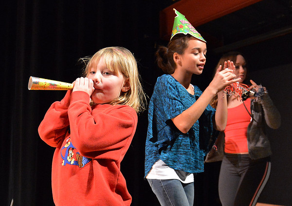 Hannah Christianson, 5, left, blows a noise maker with her cousin Ana Smith, 11,  while on stage after the count down to noon during the Happy Noon Year celebration at the Audi on Monday.December 31, 2012<br /> staff photo/ David R. Jennings