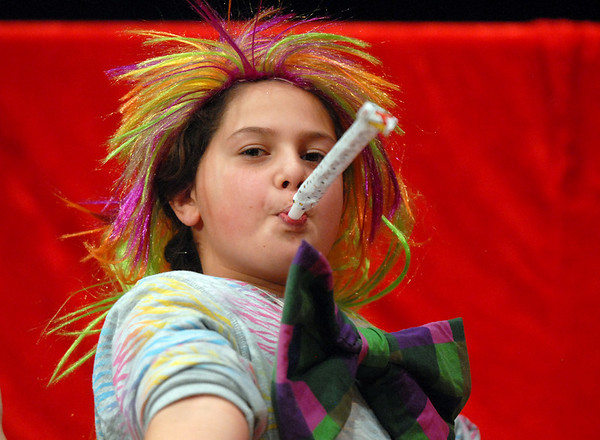 Amy Tanklefsky, 11, blows a noisemaker for the Happy Noon Year celebration on Thursday at the Audi after performing with the Salida Circus on stage. <br /> <br /> December 31, 2009<br /> Staff photo/David R. Jennings