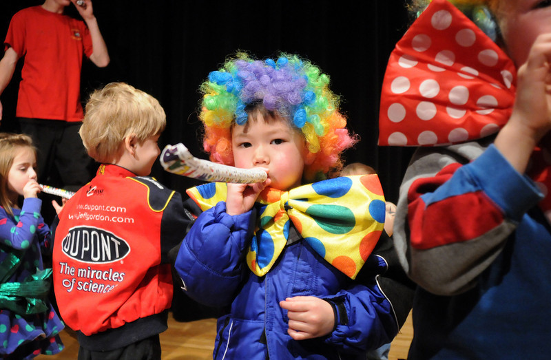 Nathan McCracken, 3, center, blows a noisemaker for the Happy Noon Year celebration on Thursday at the Audi after performing with the Salida Circus.  Children in the audience were invited to perform with the circus members.<br /> <br /> December 31, 2009<br /> Staff photo/David R. Jennings
