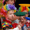 Michael Lee Kastner, 5, spins a plate while audience members perform with the Salida Circus during the Happy Noon Year celebration on Thursday at the Audi. <br /> <br /> December 31, 2009<br /> Staff photo/David R. Jennings