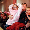 Peggy Heath, center, with her children Krissy, 7, left, and Joey, 5, watch the Salida Circus perform at the Happy Noon Year celebration at the Audi on Thursday . <br /> <br /> December 31, 2009<br /> Staff photo/David R. Jennings