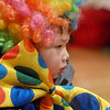 Nathan McCracken, 3, was dressed as a clown, while audience members perform with  the Salida Circus for the Happy Noon Year celebration on Thursday at the Audi. <br /> <br /> December 31, 2009<br /> Staff photo/David R. Jennings