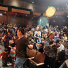 The standing room only crowd stretches with the Salida Circus before the Happy Noon Year celebration on Thursday at the Audi. <br /> <br /> December 31, 2009<br /> Staff photo/David R. Jennings