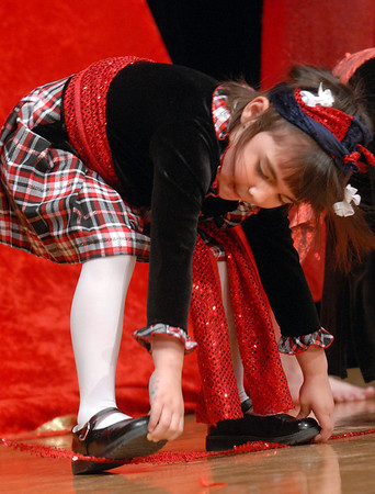 "Jaylyn Montoya, 5, ""walks on her hands""  while audience members perform with the Salida Circus during Happy Noon Year celebration on Thursday at the Audi. <br /> <br /> December 31, 2009<br /> Staff photo/David R. Jennings"