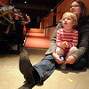 Julie Rodgers with her daughter Claire Rodgers-McLin, 3, watches the Salida Circus perform at the Happy Noon Year celebration on Thursday at the Audi.<br /> <br /> December 31, 2009<br /> Staff photo/David R. Jennings