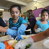 Emerald Elementary School 2nd graders Marco Coronado Barrios, left, Ilian Arello and Marlen Guitierrez fill their plates with healthy snacks they prepared during the Healthy Learning Paths program by Dr. Chris Marchioni on Tuesday.<br /> <br /> October 20, 2009<br /> Staff photo/David R. Jennings