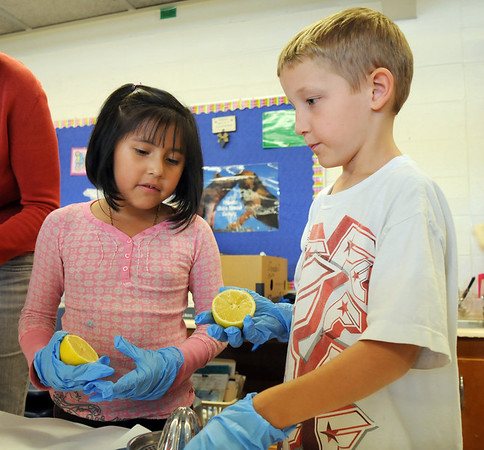 Emerald Elementary School 2nd graders Leslie Villegas, left, and Striker Huff prepare to juice lemons for a healthy snack for the Healthy Learning Paths program by Dr. Chris Marchioni on Tuesday.<br /> <br /> October 20, 2009<br /> Staff photo/David R. Jennings