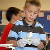 Mike Gross, Emerald Elementary School 2nd grader, puts cream cheese on a celery stick while preparing healthy snacks for the Healthy Learning Paths program by Dr. Chris Marchioni on Tuesday.<br /> <br /> October 20, 2009<br /> Staff photo/David R. Jennings