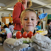 Mike Gross, Emerald Elementary School 2nd grader, adds a fourth tomato to his snack while teacher Miki Novaria watches during the Healthy Learning Paths program by Dr. Chris Marchioni on Tuesday.<br /> <br /> October 20, 2009<br /> Staff photo/David R. Jennings