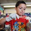 Alex Najera an Emerald Elementary School 2nd grader prepares a healthy snack during the Healthy Learning Paths program by Dr. Chris Marchioni on Tuesday.<br /> <br /> October 20, 2009<br /> Staff photo/David R. Jennings