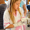 Emerald Elementary School 2nd grader Madelyn Sigala puts on gloves to prepare healthy snacks for the Healthy Learning Paths program by Dr. Chris Marchioni on Tuesday.<br /> <br /> October 20, 2009<br /> Staff photo/David R. Jennings