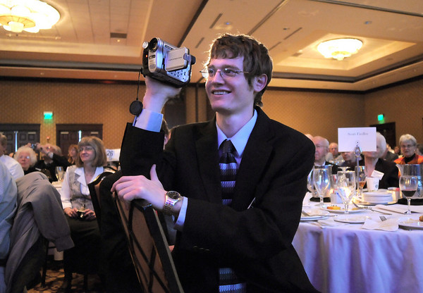 Kevin Fiedler video tapes his brother acceptance speech, Scott, the winner of the Youth Award, during the Broomfield Community Foundation's Heart of Broomfield awards ceremony at the Omni Interlocken Resort Hotel on Monday.<br /> <br /> April 18, 2011<br /> staff photo/David R. Jennings