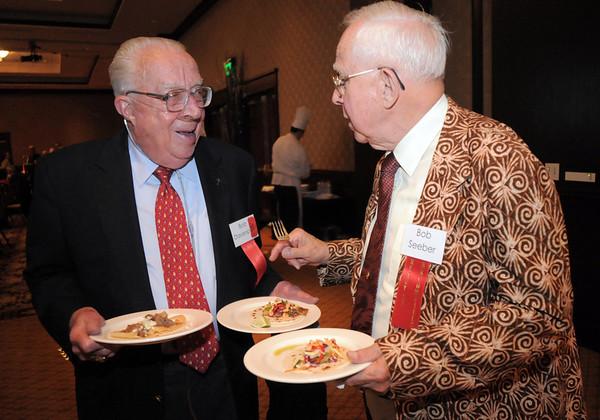 Bob Davenport, left, chats with Bob Seeber at the Broomfield Community Foundation's Heart of Broomfield awards ceremony at the Omni Interlocken Resort Hotel on Monday.<br /> <br /> April 18, 2011<br /> staff photo/David R. Jennings