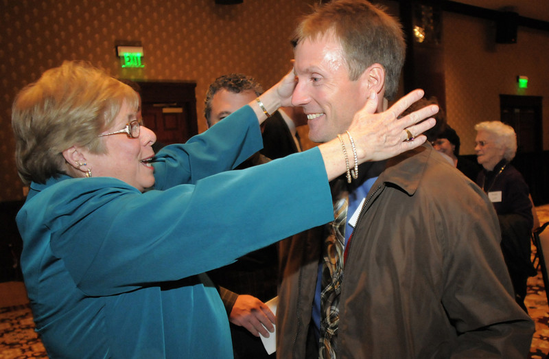 Jan Wedgewood, left, reaches to give Mike Lutz a hug after Lutz accepted the Heart of Broomfield Community Service award at the Broomfield Community Foundation's Heart of Broomfield awards ceremony at the Omni Interlocken Resort Hotel on Monday.  Wedgewood is a long time neighbor of Lutz.<br /> <br /> April 18, 2011<br /> staff photo/David R. Jennings