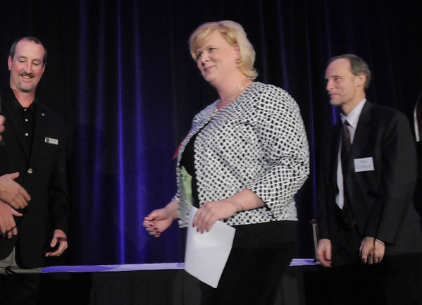 Carina Martin walks on stage to receive her Angel Award after giving her speech at the Broomfield Community Foundation's Heart of Broomfield awards ceremony at the Omni Interlocken Resort Hotel on Monday.<br /> <br /> April 18, 2011<br /> staff photo/David R. Jennings