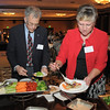 Mike Fellows, left, and Nancy Ferraro put food on their plates during the Broomfield Community Foundation's Heart of Broomfield awards ceremony at the Omni Interlocken Resort Hotel on Monday.<br /> <br /> April 18, 2011<br /> staff photo/David R. Jennings