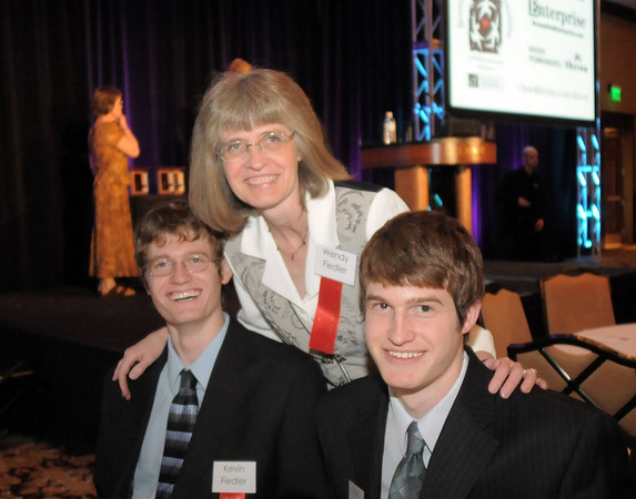 Wendy Fiedler poses with her sons Scott, left, and Kevin all Heart of Broomfield award winners past and present at the Broomfield Community Foundation's Heart of Broomfield awards ceremony at the Omni Interlocken Resort Hotel on Monday.<br /> <br /> April 18, 2011<br /> staff photo/David R. Jennings