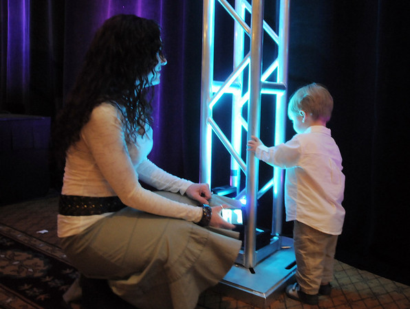 Julie Conly, left, watches her son River 2, play near the stage at the Broomfield Community Foundation's Heart of Broomfield awards ceremony at the Omni Interlocken Resort Hotel on Monday.<br /> <br /> April 18, 2011<br /> staff photo/David R. Jennings