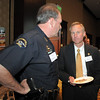 Broomfield Police Chief Tom Deland chats with Adams County District Attorney Don Quick at the Broomfield Community Foundation's Heart of Broomfield awards ceremony at the Omni Interlocken Resort Hotel on Monday.<br /> <br /> April 18, 2011<br /> staff photo/David R. Jennings