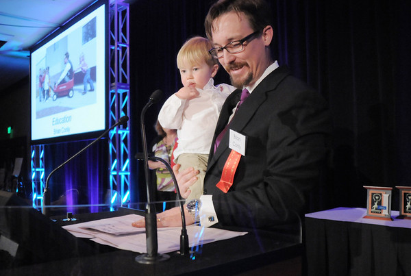 Brian Conly holds his son, River, 2,while giving his acceptance speech for the Education Award at the Broomfield Community Foundation's Heart of Broomfield awards ceremony at the Omni Interlocken Resort Hotel on Monday.<br /> <br /> April 18, 2011<br /> staff photo/David R. Jennings