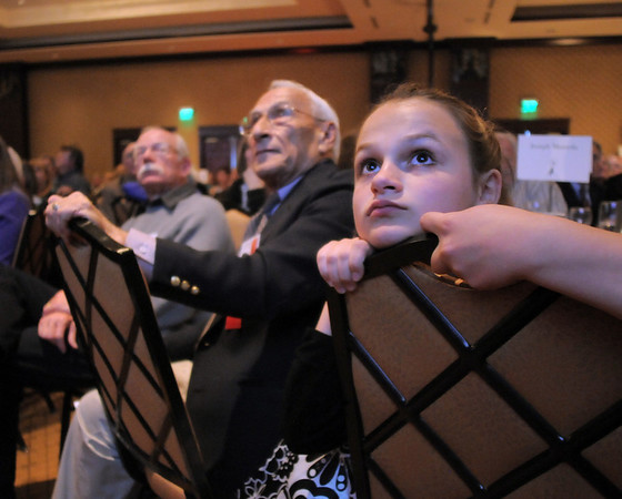 Andrea Spencer, 13, right, watches a video presentation with her grandfather Joe Mazzola, left, winner of the Philanthropy Award during the Broomfield Community Foundation's Heart of Broomfield awards ceremony at the Omni Interlocken Resort Hotel on Monday.<br /> <br /> April 18, 2011<br /> staff photo/David R. Jennings