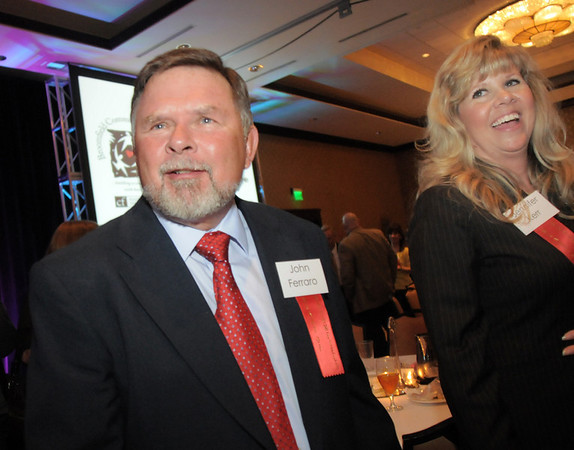 John Ferraro, left, and Jennifer Kerr after accepting their awards at the Broomfield Community Foundation's Heart of Broomfield awards ceremony at the Omni Interlocken Resort Hotel on Monday.<br /> <br /> April 18, 2011<br /> staff photo/David R. Jennings