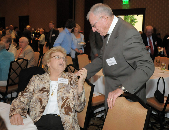 Dr. Bill Markel, right chats with Marion Mazzola at the Broomfield Community Foundation's Heart of Broomfield awards ceremony at the Omni Interlocken Resort Hotel on Monday.<br /> <br /> April 18, 2011<br /> staff photo/David R. Jennings