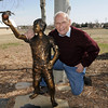Joseph Mazzola, Heart of Broomfield Philanthropic winner, poses with a statue of a boy reaching for an apple, given to him by his children at his home in Pony Estates. Mazzola said you should reach for your goals but always give back.<br /> <br /> March 24, 2011<br /> staff photo/David R. Jennings