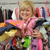 Carina Martin, Heart of Broomfield Angel award, holds children's cloths at A Precious Child. <br /> <br /> March 29, 2011<br /> staff photo/David R. Jennings