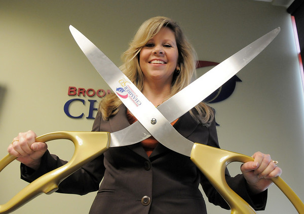 Jennifer Kerr, Gene Frank winner of Heart of Broomfield poses holding the 50th anniversary scissors at the Broomfield Chamber offices.<br /> April 7, 2011<br /> staff photo/David R. Jennings