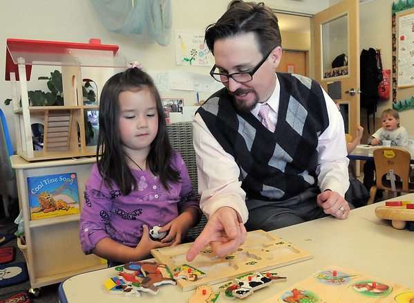 Heart of Broomfield education winner, Brian Conly, director of Bal Swan Children's Center, talks with Emma Anderson working on a puzzle during class.<br /> March 30, 2011<br /> staff photo/David R. Jennings