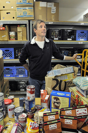 Mike Lutz, community service winner for Heart of Broomfield talks about his experiences while in the food sorting room  at FISH of Broomfield.<br /> April 5, 2011<br /> staff photo/David R. Jennings