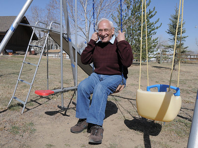 Joseph Mazzola, Heart of Broomfield Philanthropic winner, sits in a swing at his home in Pony Estates.   March 24, 2011 staff photo/David R. Jennings